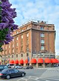 Astoria hotel and the blooming lilacs in Saint-Petersburg Stock Photos