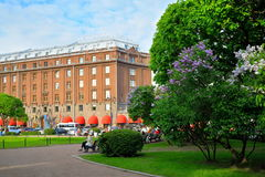 Astoria hotel on St. Isaac's square in blooming lilacs in Saint- Stock Photos