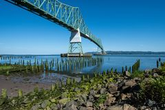 Astoria-Megler bridge, which goes over the Columbia River in Oregon. Astoria-Megler bridge, which goes over the Columbia River in Astoria Oregon. Dock pillars in stock photography