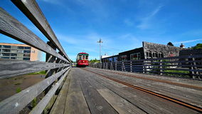 ASTORIA, OREGON - APRIL 27, 2015: Movie of Astoria Trolley going by along the waterfront on boardwalk. Astoria is a coastal town. In Oregon Coast popular with stock video