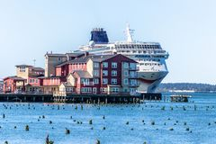 Norwegian NCL Sun cruise ship docked in downtown Astoria behind the Cannery Pier Hotel and Spa on the Columbia River royalty free stock image