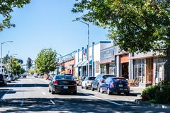 Sunny day on the street in downtown Astoria with the Astoria Megler Bridge in background royalty free stock photography