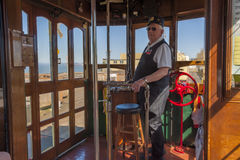 Astoria`s Waterfront Trolley Car Conductor. Astoria,Oregon,USA - April 7, 2016:  From inside Astoria`s Waterfront trolley car looking at the conductor and his Stock Photo