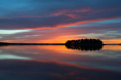 Astotin Lake Sunset. A colorful sunset decorates the horizon on Astotin Lake, Alberta, Canada royalty free stock image