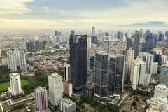 Astra tower with other skyscrapers at morning. JAKARTA - Indonesia. March 29, 2019:  Aerial view of Astra tower with other skyscrapers at misty morning in South stock photo