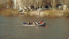 Astrakhan, Russia, 27 of April 2018: Boy-scouts Rowing Team on the Water. Volga-river in Astrakhan-city. Astrakhan, Russia, 27 of April 2018: Boy-scouts Rowing stock video