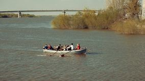 Astrakhan, Russia, 27 of April 2018: Girl-scouts and Boy-scouts Rowing Team on the Water. Wooden oars rowing water. Astrakhan, Russia, 27 of April 2018: Girl stock video