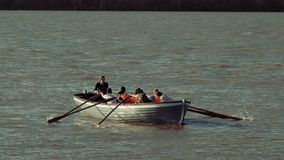 Astrakhan, Russia, 27 of April 2018: Boy scouts Rowing Team on the Water. Wooden oars rowing water. Astrakhan, Russia, 27 of April 2018: Team work. Boy-scouts stock video