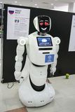 White Robot android at the exhibition of international achievements. ASTRAKHAN, RUSSIA - APRIL 2018: White Robot android at the exhibition of international stock photos