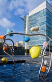 AstraZeneca Headquarters, London. LONDON, UK - MAY 15, 2014:  Colourful sculpture and water feature in front of the headquarters of the pharmaceutical Stock Photography