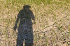 Astrazione degli agricoltori che soffrono dalla siccità Fotografia Stock