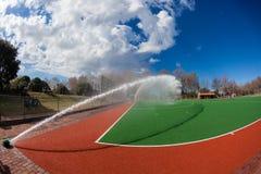 Astro草皮曲棍球水喷洒 免版税库存图片