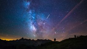 Astro time lapse milky way and stars rotating over the majestic Italian French Alps in summertime. Sliding version.
