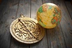 Astrolabium med jordklotet Royaltyfria Bilder