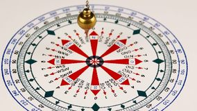 Pendulum for divination. Astrologer use pendulum for tarot and a astrological circle for divination stock video