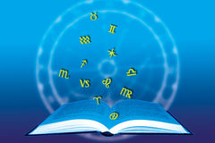 Astrological book. Open book with glyphs of all the astrological signs over a blue background with zodiacal wheel stock illustration