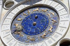 Astrological clock with gold zodiac signs in a sunny day. Astrological clock with gold zodiac signs in a sunny summer day royalty free stock image