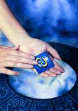 Astrological sign Cancer. With female hand and blue zodiac stock photo