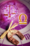Astrological sign Libra. With the symbol of scale, zodiac and talisman in form of horse shoe Royalty Free Stock Photography