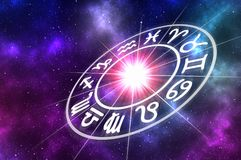 Astrological zodiac signs inside of horoscope circle. On universe background - astrology and horoscopes concept stock illustration