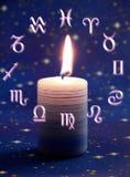 Astrologie und Kerze Stockbilder