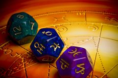 Astrology. Dices with astrological symbols over background with zodiac like a concept for astrology and divination royalty free stock photos