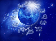 Astrology. Represents by the planet Venus with stars, rays of light and symbols of zodiac over starry Universe Royalty Free Stock Photo