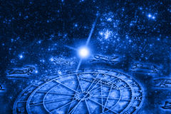 Astrology. Concept with a horoscope and signs of zodiac over starry blue Universe with copy space Stock Photo