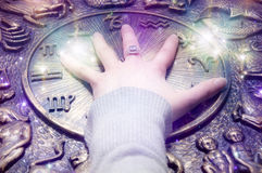 Astrology. A female hand over zodiac with stars like a concept for astrology prediction Stock Image