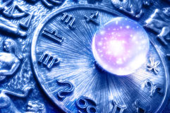 Astrology. A crystal ball with stars over zodiac like a concept for astrology and esoteric prediction royalty free stock photo