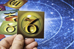 Astrology Capricorn. Hand holding an astrology card with symbol of sign of Capricorn stock images