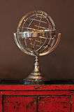 Astrology Celestial Sphere. On a vintage wooden cabinet royalty free stock image