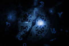 Astrology clock. In the stars Stock Photo