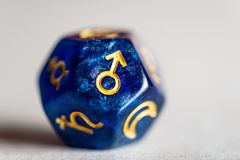 Astrology Dice with symbol of the planet Mars. On grey background stock photo