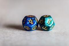 Astrology Dice with zodiac symbol of Gemini and its ruling planet Mercury stock photo