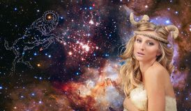 Astrology and horoscope. Aries Zodiac Sign, beautiful woman Aries on the galaxy background. Aries Zodiac Sign. Astrology and horoscope concept, beautiful woman stock image