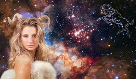 Astrology and horoscope. Aries Zodiac Sign, beautiful woman Aries on the galaxy background. Aries Zodiac Sign. Astrology and horoscope concept, beautiful woman royalty free stock image