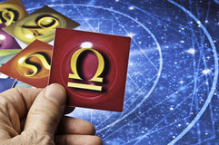 Astrology Libra. Hand holding an astrology card with symbol of sign of Libra Royalty Free Stock Photos