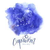 Astrology sign Capricorn. On blue watercolor background with modern lettering. Zodiac constellation with  shiny star shapes. Part of zodiacal system and ancient Stock Photo