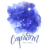 Astrology sign Capricorn. On blue watercolor background with modern lettering. Zodiac constellation with  shiny star shapes. Part of zodiacal system and ancient Royalty Free Stock Photos