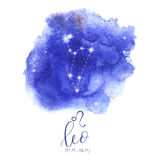 Astrology sign Leo. On blue watercolor background with modern lettering. Zodiac constellation with  shiny star shapes. Part of zodiacal system and ancient Stock Photography