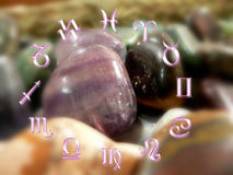 Astrology and stones. Astrological signs and magical stones in blur Stock Photos