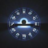 Astrology symbol Libra light flare. 12 zodiac symbols wheel set shining blue light halo. Glowing horoscope sign Stock Image