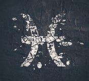 Astrology symbols. Fish sign. Astrological symbol. Fish sign. Grunge splatter texture Stock Photos