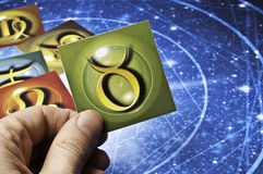 Astrology Taurus. Hand holding an astrology card with symbol of sign of Taurus stock photography