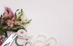 Astromeria Flowers and garden tools on White background with Copy Space Royalty Free Stock Photo
