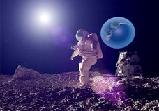 The astronaut. On a background of a planet