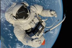 The astronaut. On a background of a planet Royalty Free Stock Photos