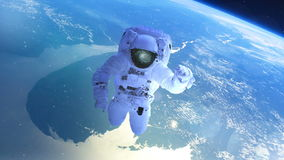 Astronaut above the earth in open space