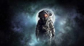 Astronaut explorer in space. Mixed media Stock Photos